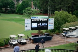 Photo of a sponsor board at a golf event