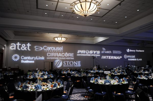 photo of the sponsor logos projected on a wall